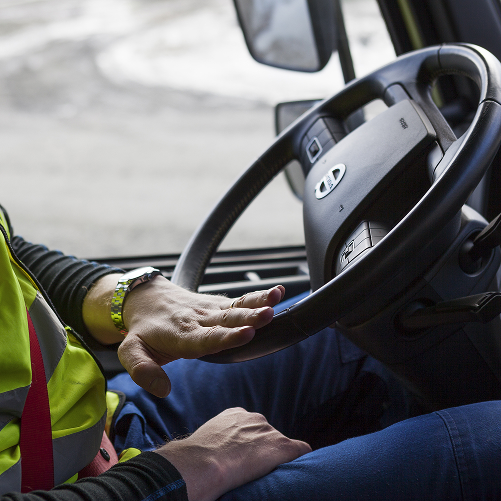 Driver steering a Volvo FH